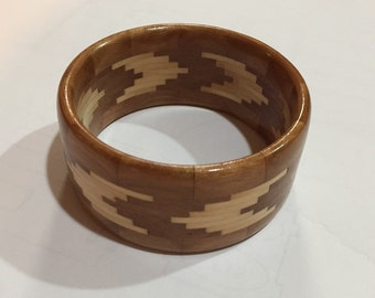 Segmented wooden bangle with V pattern
