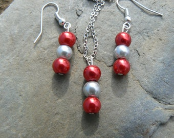 Red and silver pearl necklace and earrings set.