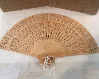 Pierced wood hand fan
