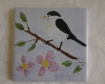 Chickadee on a branch with blossoms hand-painted on a 4 inch ceramic tile.