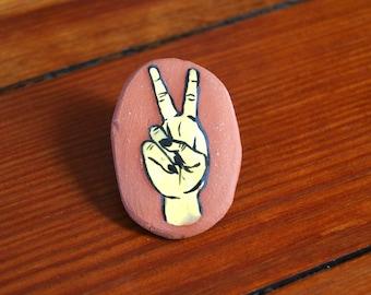 Ceramic peace sign pin