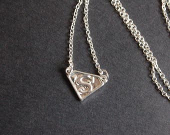 Silver tone small superman necklace