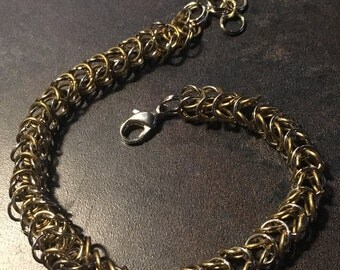 Silver and gold colored bracelet