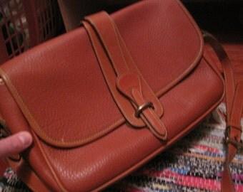 cognac dooney and bourke cross body leather handbag