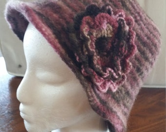 Felted hat with decorative flower