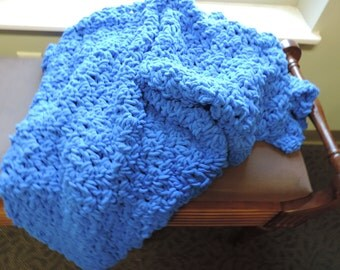 crocheted blue throw