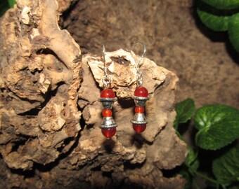 Silver drop earrings with carnelian in hourglass form