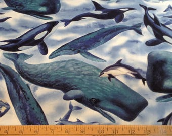 Whales in ocean cotton fabric by the yard
