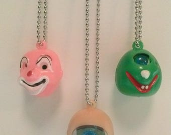 Dog Tag Necklace, Blinking Eyeball, Cyclopes Monster, or a creepy Jiggly eyed Clown !