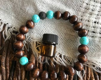 Dark wood diffuser bracelet with a hint of turquoise