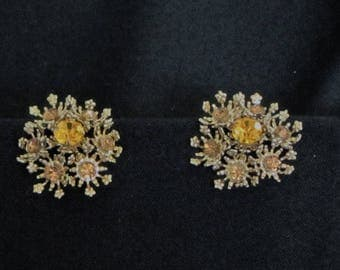 Stunning Vintage Sunburst Filigree Clip on Earrings with Topaz Colored Crystals.