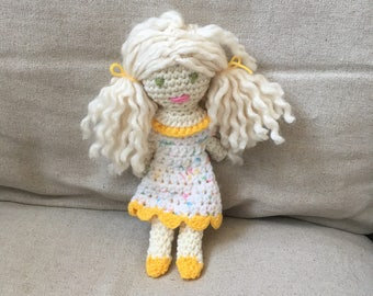 Spring crocheted yellow sweet ragdoll