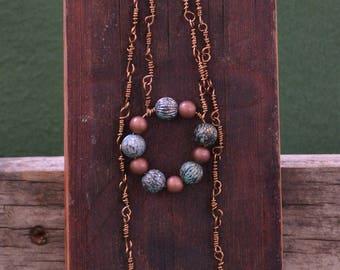 Bronze and blue metallic bead-pendant necklace