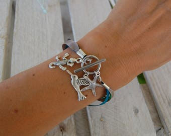 Ribbon bracelet and starfish, hummingbird and gecko charms