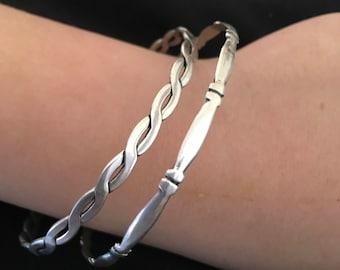 Criss cross silver bracelets