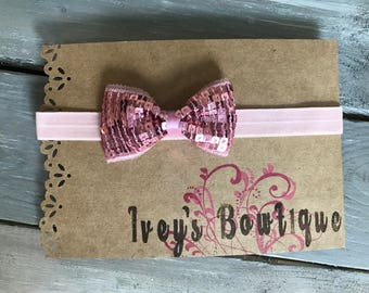 Adjustable pink sequined bow headband