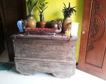 Antique wooden Chest, hand carved , made of teak and 4 rooling wheels It's so old shown by the colour of the wood