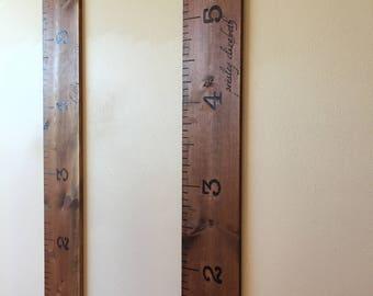 Rustic wood burned growth chart