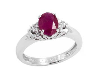18 kt white gold ring with diamonds and rubies, hand finished