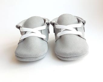 Baby moccasins light grey.
