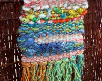 Small Weaving with Hand Spun Wool, Silk, Sparkle in green, orange, and blue tones. Number Five