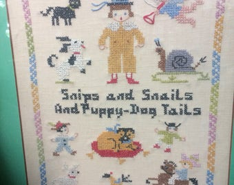 Snips and Snails and Puppy Dog Tails! A lovely antique sampler, reframed.