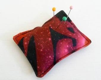 Red, Plum Kanji Print Pincushion filled with walnut shells