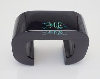 Superb black lucite art bracelet with real iridescent beetle