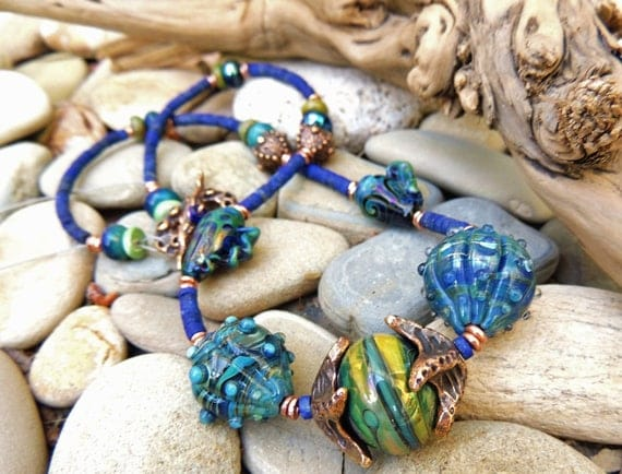 Art Glass Necklace blue seashell necklace with Lapis and bronze and artisan Lampwork