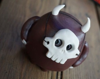 hand thrown, ceramic demon with skull mask