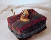 Little Stoneware Sea Otter Pincushion with Blue Starfish on a Velvet Tuffet