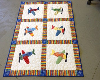 Airplane appliqued baby quilt flannel backed multi colored crib blanket handmade