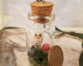 "Barn owl, red amanita mushroom, tiny black rocks, live moss, 2"" glass bottle, terrarium, necklace."