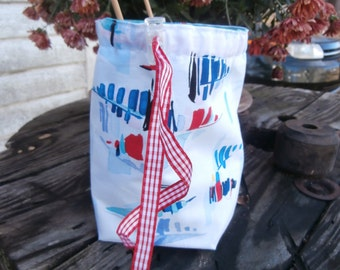 Little sock knitting bag with watercolor sailboats.