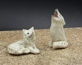 Miniature wolf pair -  porcelain sculpture