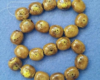 22 Speckled Golden Yellow Glazed Porcelain Beads - puffed ovals, 18mm x 16mm, full 15 inch strand