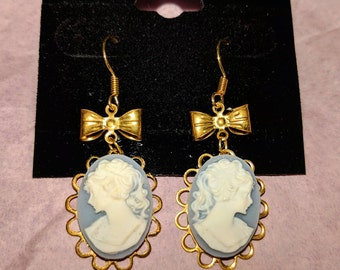 Pale Blue Lady Cameo Earrings, gold bows and settings