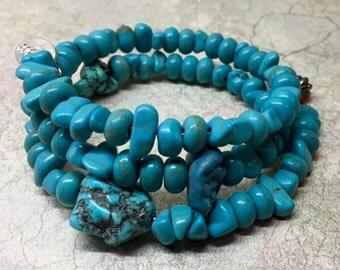 Turquoise stone three-wrap bracelet. Fits all wrist sizes.