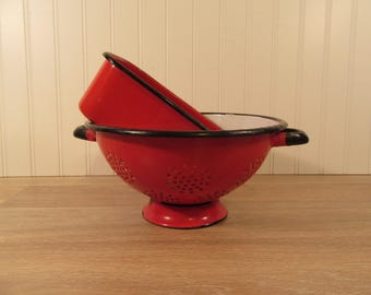 Beautiful vintage weighty red enamelware footed strainer with black trim and white interior PLUS  refrigerator box  for one price