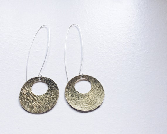 The Jupiter Earrings: Textured Brass   Coins paired with long Sterling earwire, minimalist earrings