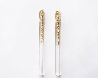 Handmade large long chandelier drop facet geometric statement dangle resin earrings in gold glitter and clear.