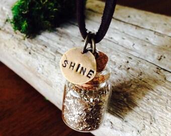 Shine glittle bottle necklace on leather cord