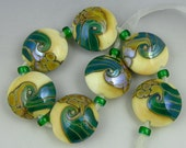 a set of 7 lentil beads in ivory with iridescent green and gold glass handmade lampwork - Aruba Shores