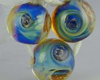 handmade lampwork glass beads a set of 3 swirled blue rounds done in encased silverglass - Blue Moons