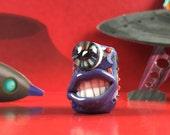 Purple one eyed grinning monster dreadlocks bead