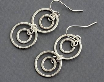Sterling silver hammered hoop dangle earrings geometric jewelry minimalist contemporary jewelry open circle orbital earrings artisan hoops