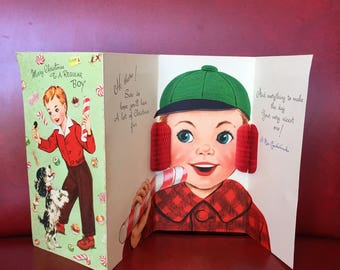 Vintage Christmas Card with Boy, Candy Cane, Dog and Honeycomb Ear Muff - Greeting Card by Gibson