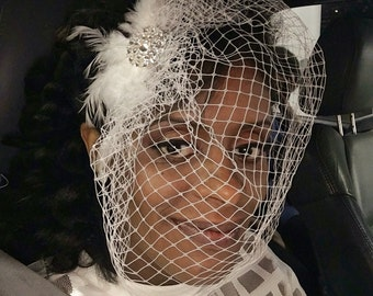 Bridal rhinestone and feather fascinator with russian net veil