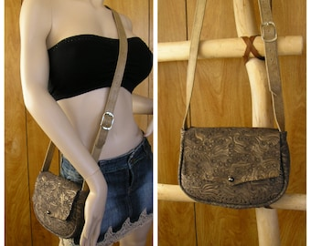 """Suede leather crossbody purse, bronze embossed 9"""" x 6"""" x 2"""", adjustable strap 44"""" to 49"""", ball button , one front pocket & one inside pocket"""