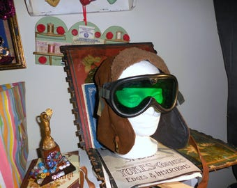 The Aviator / Cap And Vintage Goggles